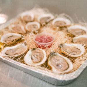fresh oysters in a tray for oyster delivery