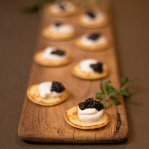 Caviar on blini with sour cream