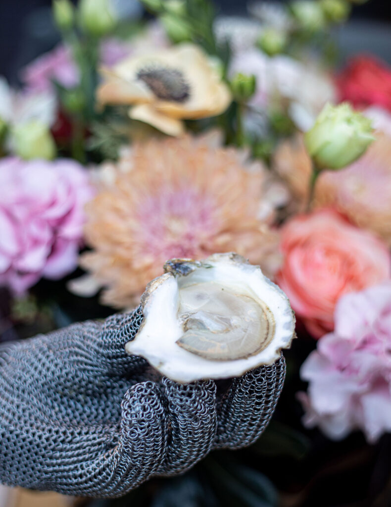 Shucked oyster with fresh flowers