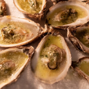 Grilled oysters made with tarragon butter