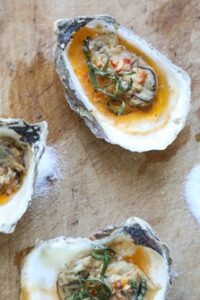 picure of Grilled Oysters with Chipotle Bourbon Butter